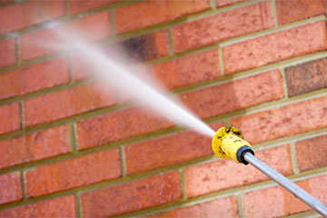 pressure washer washing side of house